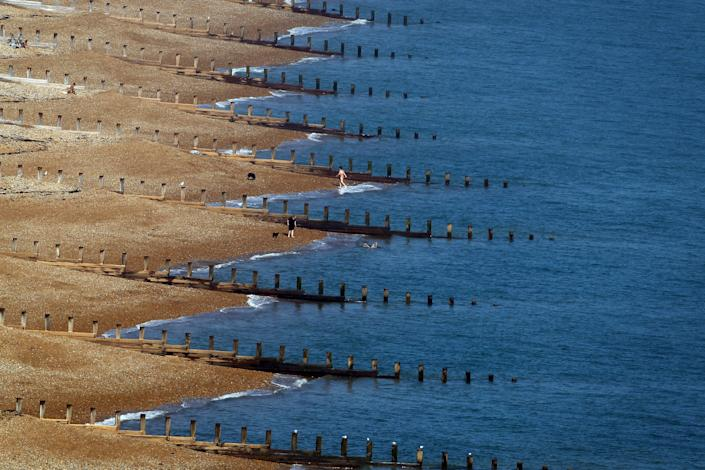People enjoy the warm weather on Eastbourne beach on September 28, 2011 in Eastbourne, England. Much of the UK is enjoying a spell of unseasonably hot weather which is expected to last into next week. (Photo by Dan Kitwood/Getty Images)
