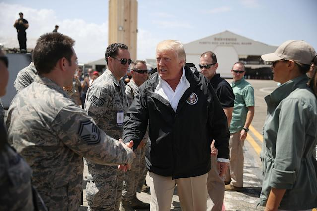 <p>President Donald Trump greets U.S Air Force airmen as he arrives at the Muniz Air National Guard Base as he makes a visit after Hurricane Maria hit the island on Oct. 3, 2017 in Carolina, Puerto Rico. (Photo: Joe Raedle/Getty Images) </p>