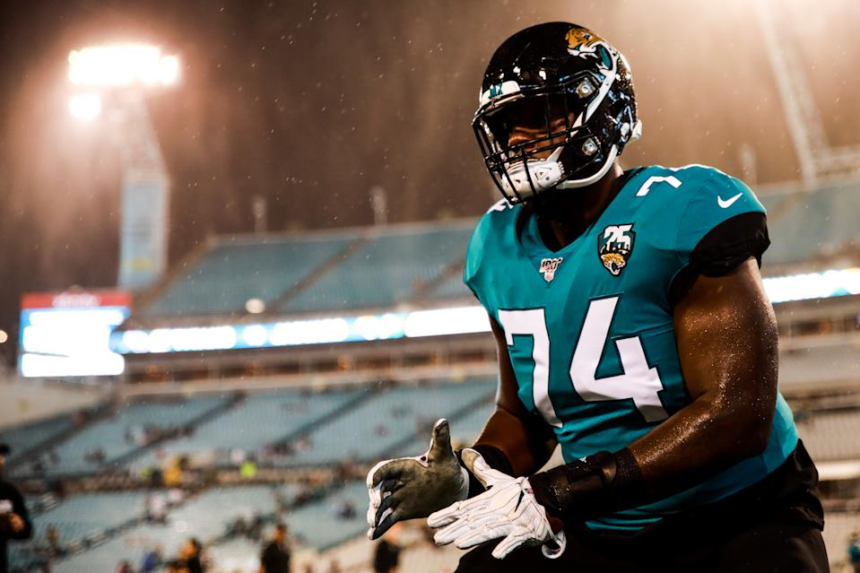 Cam Robinson practices in the pouring rain before facing the Titans on Sept. 19, 2019 in Jacksonville, Florida.