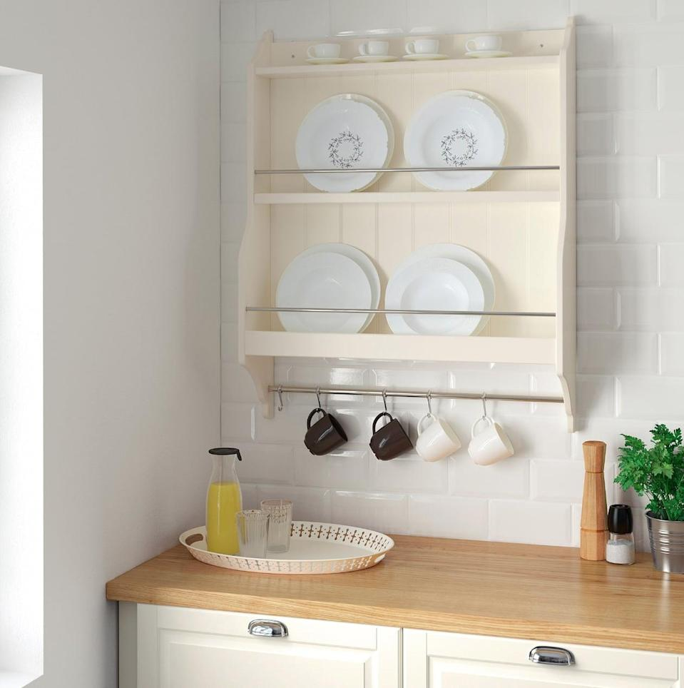 "<p>Display your dishes in style with the <a href=""https://www.popsugar.com/buy/Tornviken%20Plate%20Shelf-446988?p_name=Tornviken%20Plate%20Shelf&retailer=ikea.com&price=60&evar1=casa%3Aus&evar9=46151613&evar98=https%3A%2F%2Fwww.popsugar.com%2Fhome%2Fphoto-gallery%2F46151613%2Fimage%2F46152177%2FTornviken-Plate-Shelf&list1=shopping%2Cikea%2Corganization%2Ckitchens%2Chome%20shopping&prop13=api&pdata=1"" rel=""nofollow noopener"" target=""_blank"" data-ylk=""slk:Tornviken Plate Shelf"" class=""link rapid-noclick-resp"">Tornviken Plate Shelf</a> ($60). The wall design makes it easy for you to see and reach things without the hassle.</p>"