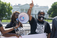 LaTosha Brown, left, and Cliff Albright, both with Black Voters Matter, rally for voting rights, Tuesday, Aug. 24, 2021, near the White House in Washington. (AP Photo/Jacquelyn Martin)