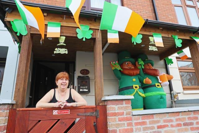 Marie Griffin at her home in Oriel Street in Dublin which is decorated to mark St Patrick's Day (Brian Lawless/PA)