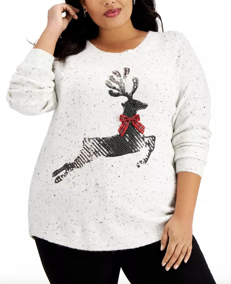 <p>Pair this <span>Karen Scott Plus-Size Sequin Reindeer Sweater</span> ($20, originally $55) with a red cardigan or coat to make your outfit complete.</p>