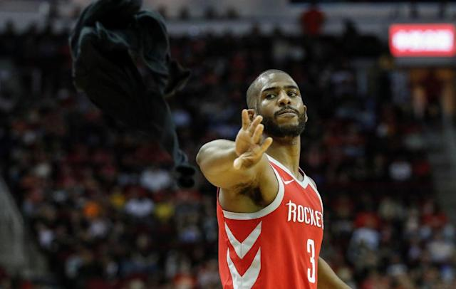 Here's hoping Chris Paul isn't throwing in the towel too often with his new Houston Rockets contract. (Getty Images)