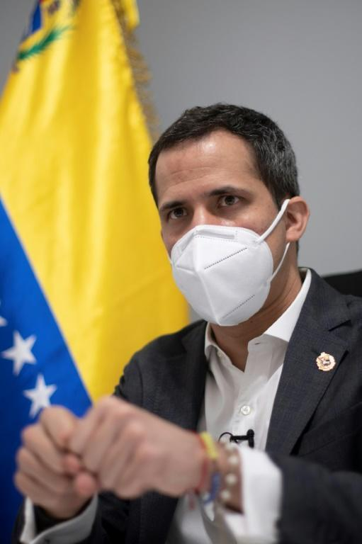 Venezuelan opposition leader Juan Guaido gestures during an interview with AFP at his home in Caracas on November 30, 2020