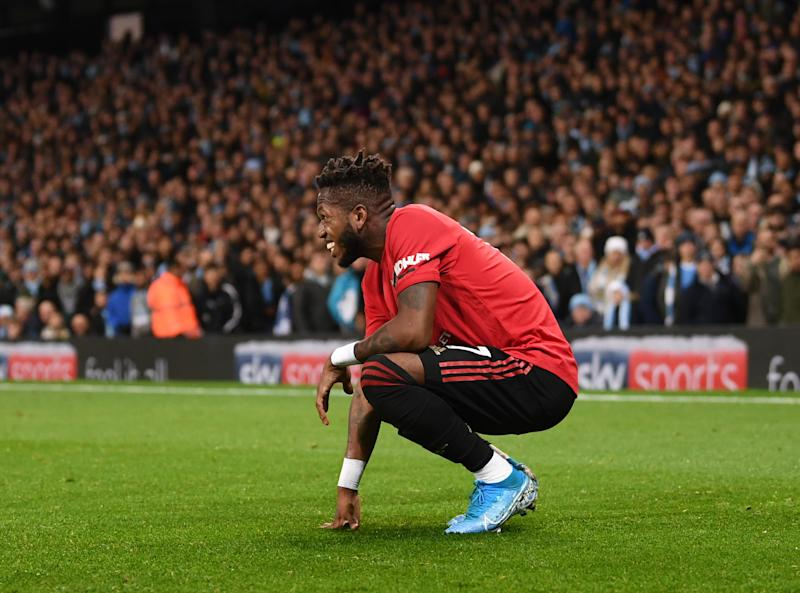 MANCHESTER, ENGLAND - DECEMBER 07: Fred of Manchester United reacts after being hit by a lighter thrown from the crowd during the Premier League match between Manchester City and Manchester United at Etihad Stadium on December 07, 2019 in Manchester, United Kingdom. (Photo by Laurence Griffiths/Getty Images)