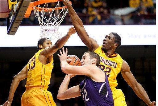 Northwestern's Alex Olah, center, is blocked by Minnesota forward Rodney Williams Jr. (33) and Trevor Mbakwe (32) in the first half of an NCAA college basketball game, Sunday, Jan. 6, 2013, in Minneapolis. (AP Photo/Andy Clayton King)