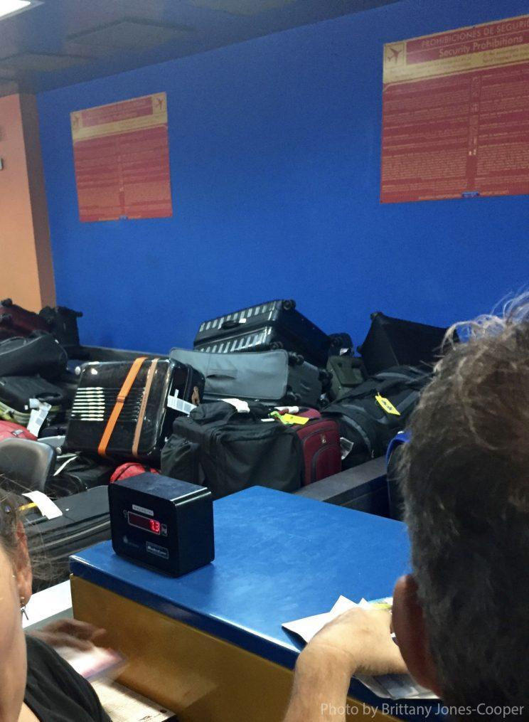 Checked luggage thrown in a pile at Havana's airport