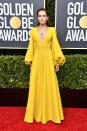 """""""The Politician"""" star arrived looking radiant in marigold. (Photo by Frazer Harrison/Getty Images)"""