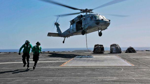 This image released,May 10, 2019 shows a naval logistics specialists attaches cargo to an MH-60S Sea Hawk helicopter from the 'Nightdippers' of Helicopter Sea Combat Squadron 5 from the flight deck of the Nimitz-class aircraft carrier USS Abraham Lincoln. (Mc3 Amber Smalley/AFP/Getty Images, FILE)