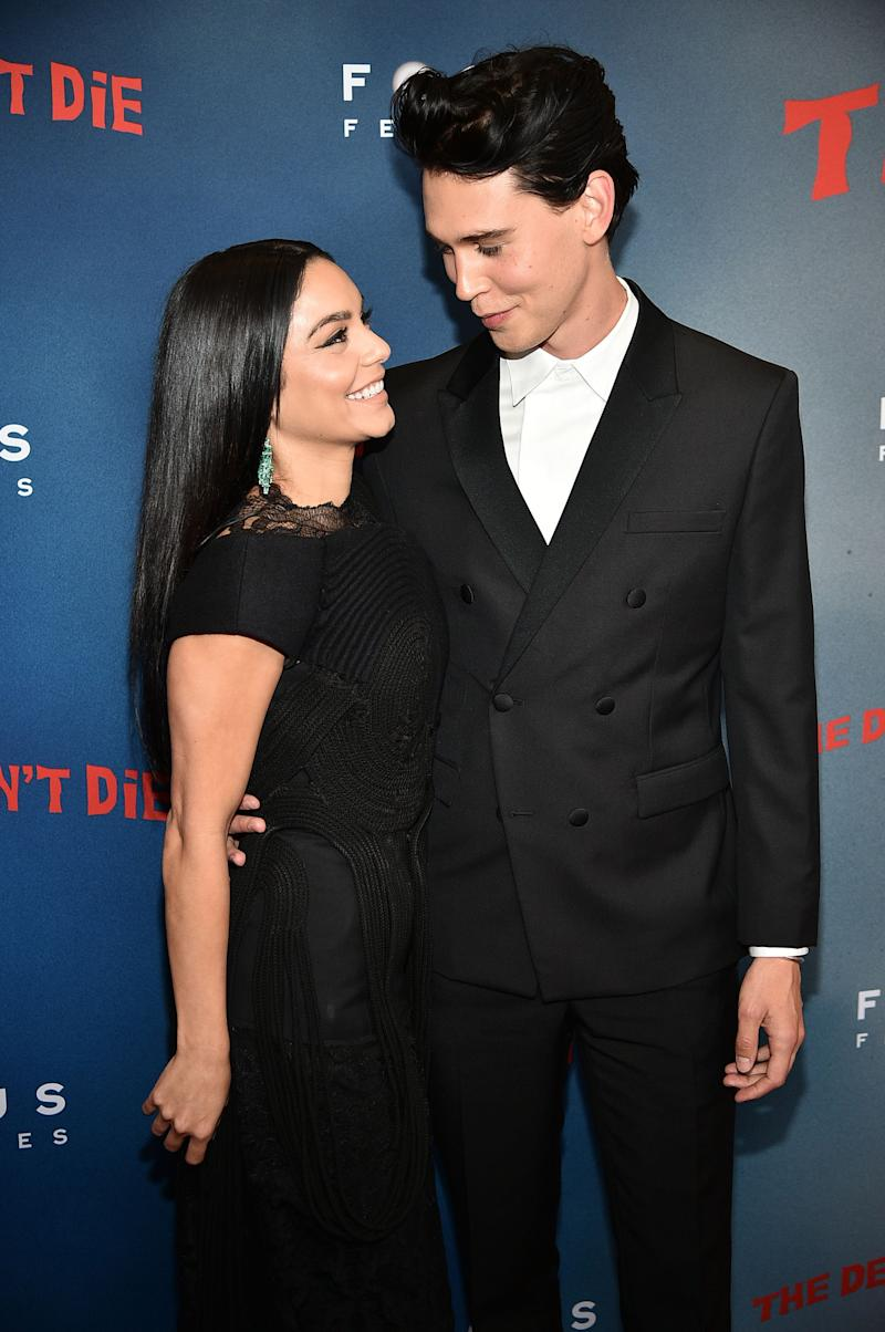 Vanessa Hudgens and Austin Butler share a love picture in all-blsck outfit as they stare intensely at each other.