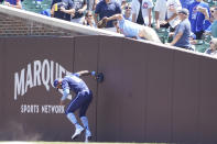 Chicago Cubs right fielder Jason Heyward (22) can't catch a ball hit by St. Louis Cardinals' Paul Goldschmidt as a fan interfered with the ball and Goldschmidt was called out during the first inning of a baseball game, Friday, July 9, 2021, in Chicago. (AP Photo/David Banks)
