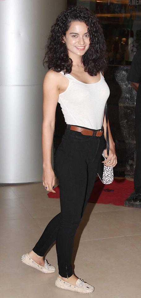 Kangana is one true blue fashionista! She's certainly impressed the fashion police with her versatile style and edgy fashion sense. We're loving her minimalistic chic look here. So simple yet so stylish!