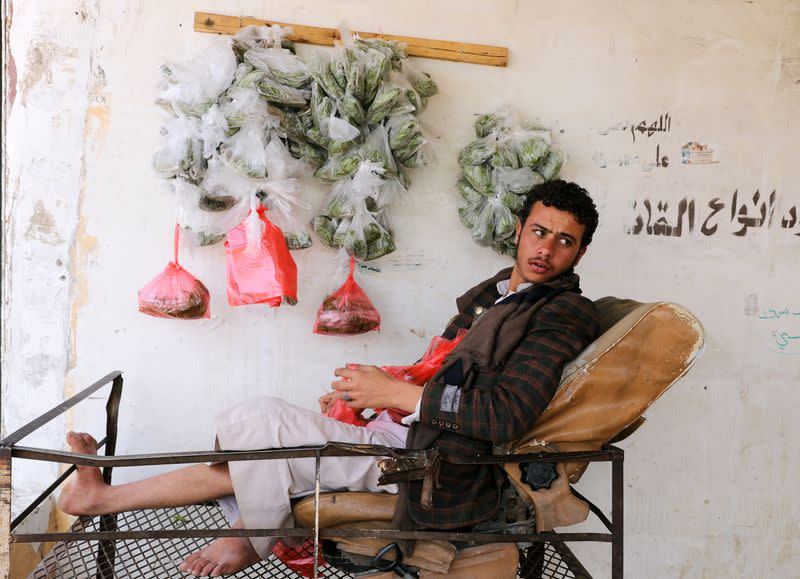 Vendor selling qat, a mild stimulant, waits for customers at a qat market amid concerns of the spread of the coronavirus disease (COVID-19) in Sanaa