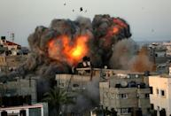 A ball of fire erupts from a building in Gaza City's Rimal residential district on May 16 during Israeli bombardment on the Hamas-controlled enclave