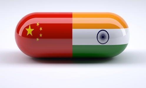 """<span class=""""attribution""""><a class=""""link rapid-noclick-resp"""" href=""""https://www.shutterstock.com/image-illustration/pill-chinese-indian-flag-wrapped-around-547488079"""" rel=""""nofollow noopener"""" target=""""_blank"""" data-ylk=""""slk:Shutterstock/FabioBerti"""">Shutterstock/FabioBerti</a></span>"""