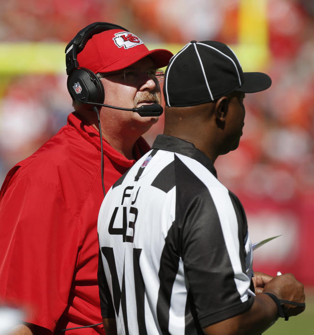 Kansas City Chiefs coach Andy Reid, left, watches a replay next to field judge Terry Brown (43) during the first half of an NFL football game against the New York Giants at Arrowhead Stadium in Kansas City, Mo., Sunday, Sept. 29, 2013. (AP Photo/Ed Zurga)