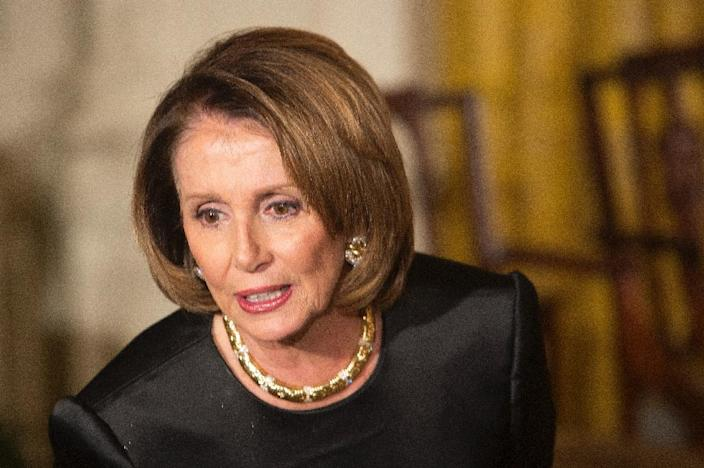 """US House Minority Leader Nancy Pelosi, pictured at the White House on December 6, 2015, warned December 16 of the """"immorality"""" in funding a spending package including tax cuts that will add to the national debt (AFP Photo/Chris Kleponis)"""
