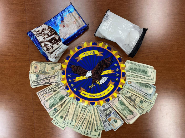 This undated photo provided by the Maine Drug Enforcement Agency shows a marble cake which contained about 2 pounds of cocaine, and cash, seized from a vehicle in Gardiner, Maine. A New York man and a Maine woman are facing charges, Wednesday, July 21, 2021, after the cocaine disguised as a cake was seized from their vehicle, authorities said. (Maine Drug Enforcement Agency via AP)