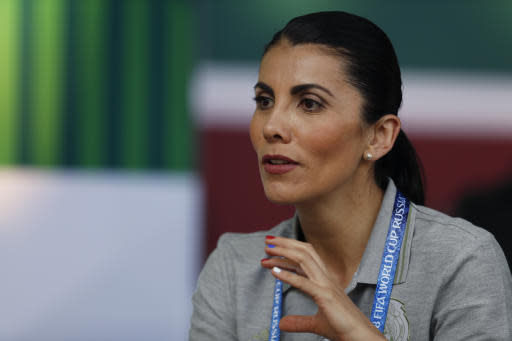 """In this photo taken on Wednesday, June 20, 2018, nutritionist Beatriz Boullosa speaks during an interview after a training session of Mexico at the 2018 soccer World Cup in Moscow, Russia. Mexico's mantra for this World Cup is """"No Excuses,"""" and that includes no complaining about the food. The team brought two tons of food to Russia, along with everything necessary to make their players favorites, including traditional tacos, cheesy quesadillas and, of course, their hot salsas. (AP Photo/Eduardo Verdugo)"""