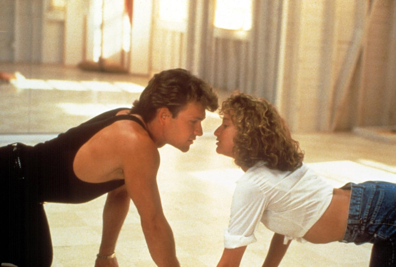 <p>Baby (Jennifer Grey) and Johnny (Patrick Swayze) joke around and lip-synch during their afternoon session, eventually crawling toward each other for a kiss.</p>