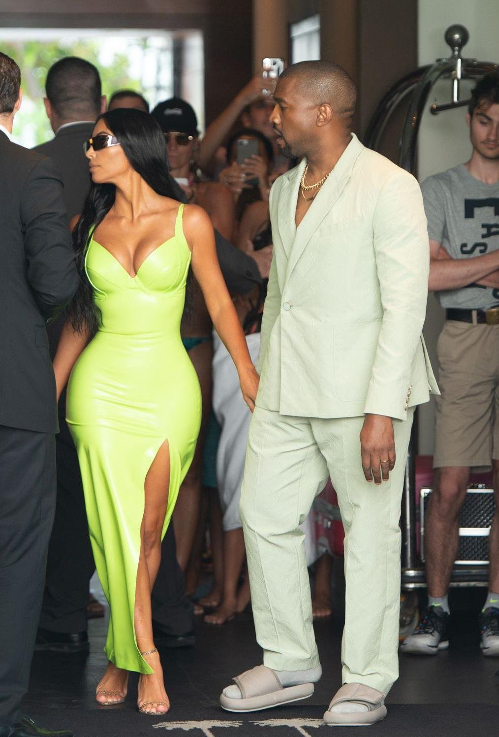 Kim Kardashian and Kanye West at 2 Chainz's wedding to Kesha Ward. West is wearing a Louis Vuitton suit and Yeezy slides. (Photo: South Beach Photo/REX/Shutterstock