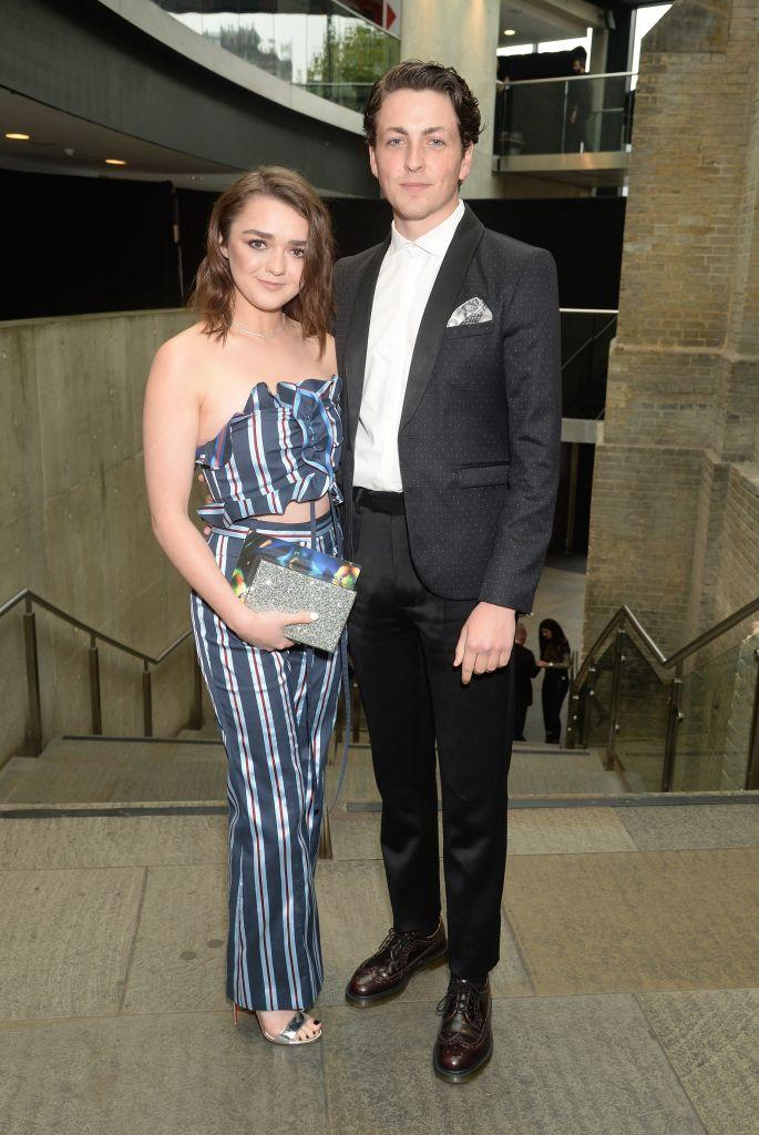 LONDON, ENGLAND - OCTOBER 18: Maisie Williams (L) and Ollie Jackson attend The Q Awards 2017, in association with Absolute Radio, at The Roundhouse