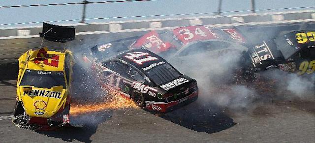 Kurt Busch (41) Joey Logano (22) David Ragan (34) and Michael McDowell (95) collide in Turn 4 during the NASCAR Aaron's 499 Sprint Cup series auto race at Talladega Superspeedway, Sunday, May 4, 2014, in Talladega, Ala. (AP Photo/Skip Williams)