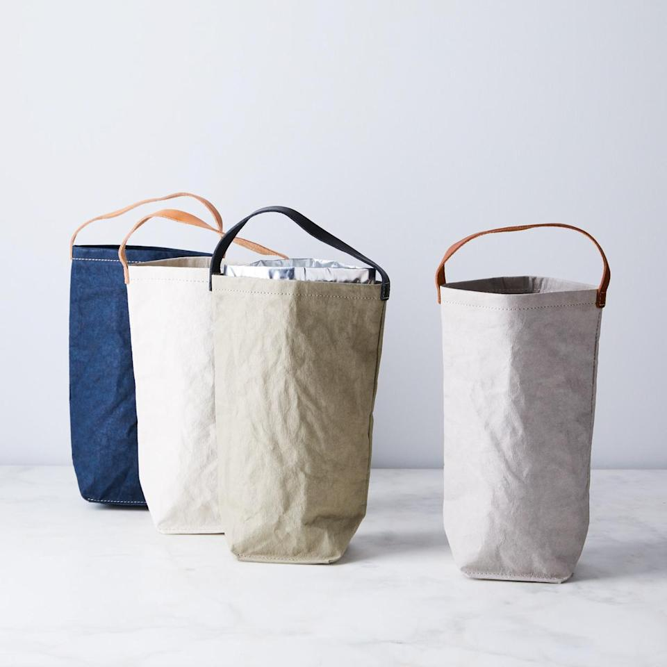 """<p>A special bottle becomes even more gift-worthy when you present it in this Italian-made wine bag. Made from water- and stain-resistant paper that's stretched and tanned for a leather-like look, it comes in indigo, natural, sage, blush, stone, brown, and black. You can also grab one with or without a removable cooler pack.</p> <p><strong><em>Buy Now: </em></strong><em>Uashmama Wine Bag and Cooler, from $26, <a href=""""https://www.anrdoezrs.net/links/9104911/type/dlg/sid/MSL15GiftIdeasfortheWineLoversinYourLifeameyerChrGal7993256202010I/https://food52.com/shop/products/4108-wine-bag-cooler"""" rel=""""nofollow noopener"""" target=""""_blank"""" data-ylk=""""slk:food52.com"""" class=""""link rapid-noclick-resp"""">food52.com</a>.</em></p>"""