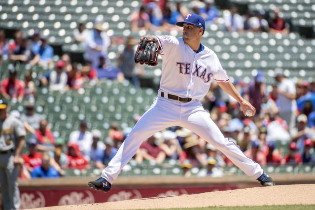 Texas Rangers starting pitcher Joe Palumbo, making his major league debut, works against the Oakland Athletics during the first inning of the first baseball game of a doubleheader Saturday, June 8, 2019, in Arlington, Texas. (AP Photo/Jeffrey McWhorter)