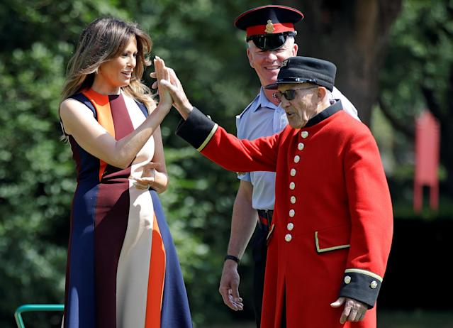 "<p>First lady Melania Trump high-fives with a British military veteran known as a ""Chelsea Pensioner"" during a game of bowls at The Royal Hospital Chelsea in central London, Britain July 13, 2018. (Photo: Luca Bruno/Pool via Reuters) </p>"