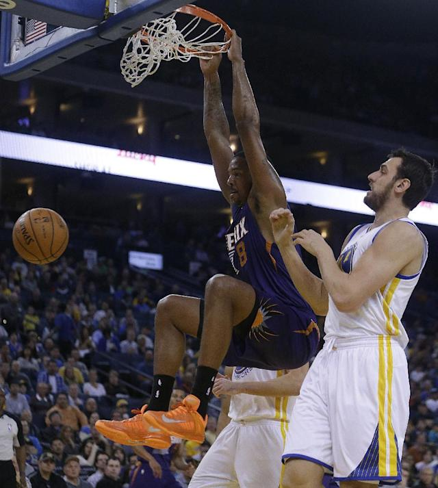 Phoenix Suns' Channing Frye (8) scores past Golden State Warriors' Andrew Bogut, right, during the first half of an NBA basketball game Sunday, March 9, 2014, in Oakland, Calif. (AP Photo/Ben Margot)