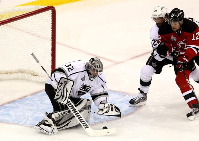 NEWARK, NJ - JUNE 02: Jonathan Quick #32 of the Los Angeles Kings covers the puck as Jarret Stoll #28 of the Los Angeles Kings and Alexei Ponikarovsky #12 of the New Jersey Devils look on during Game Two of the 2012 NHL Stanley Cup Final at the Prudential Center on June 2, 2012 in Newark, New Jersey.  (Photo by Jim McIsaac/Getty Images)