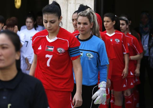 Players from the Palestinian women's football team take to the pitch for a qualifying match against Thailand on April 3, 2017 (AFP Photo/ABBAS MOMANI)