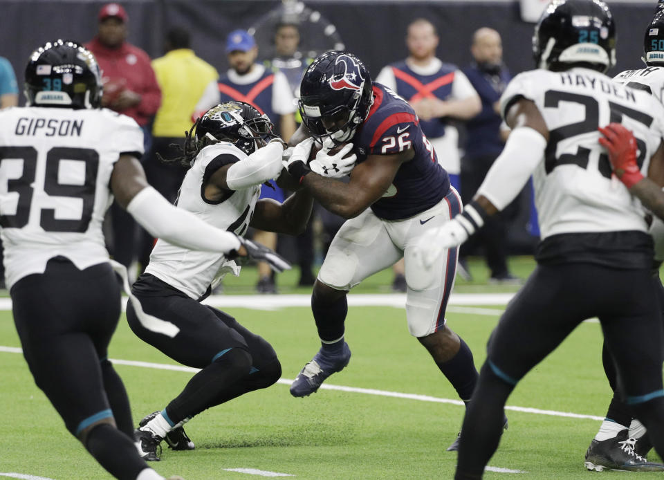 Houston Texans running back Lamar Miller (26) runs for a touchdown against the Jacksonville Jaguars during the first half of an NFL football game, Sunday, Dec. 30, 2018, in Houston. (AP Photo/David J. Phillip)