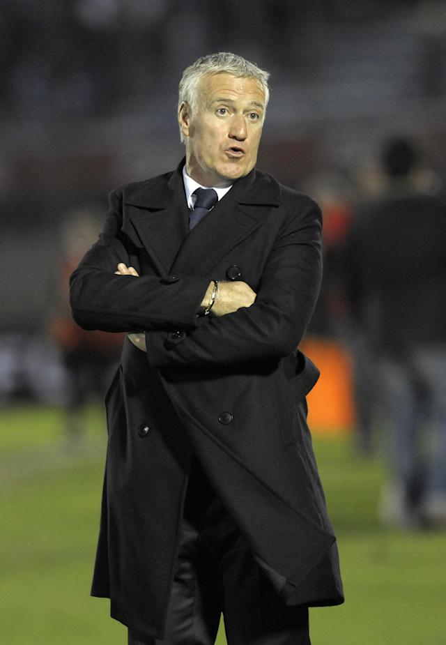 FILE - In this June 5, 2013, file photo, France's coach Didier Deschamps gestures after a friendly soccer game against Uruguay in Montevideo, Uruguay. The French production line continues to turn out some of the most sought-after talents in the world game, but following in the footsteps of the 1998 world champions and 2006 runners-up has proved no easy task. Typically cited as among the favourites ahead of any major tournament, Les Bleus failed to win a single game at either UEFA EURO 2008 or the 2010 FIFA World Cup, and took a laborious route through to the quarter-finals at EURO 2012.(AP Photo/Matilde Campodonico, File)