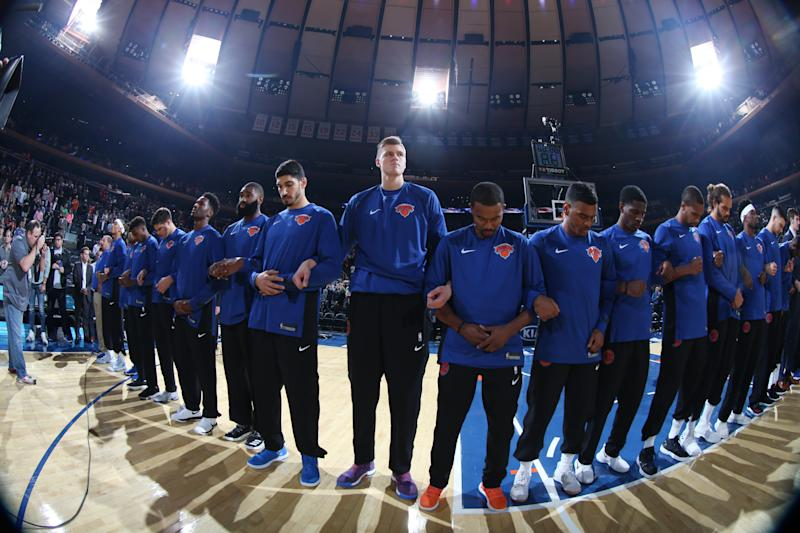 The New York Knicks stand for the national anthem with linked arms before a preseason game on Oct. 3, 2017. (Nathaniel S. Butler via Getty Images)