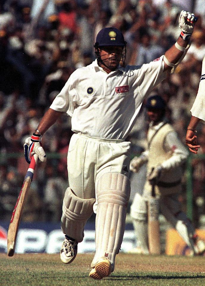 (FILES) In this picture taken 31 January 1999, Indian batsman Sachin Tendulkar waves to the crowd as he completes his century during the first Test match between Pakistan and India on Indian soil in twelve years in Madras.   Tendulkar who will travel to Pakistan for the forthcoming tour of One Day Internationals and Test matches next month for India's first Test series there since 1989, commented 27 February, to an Indian newspaper that keeping his weight in check will overshadow any fears about personal safety. AFP PHOTO/ John MACDOUGALL