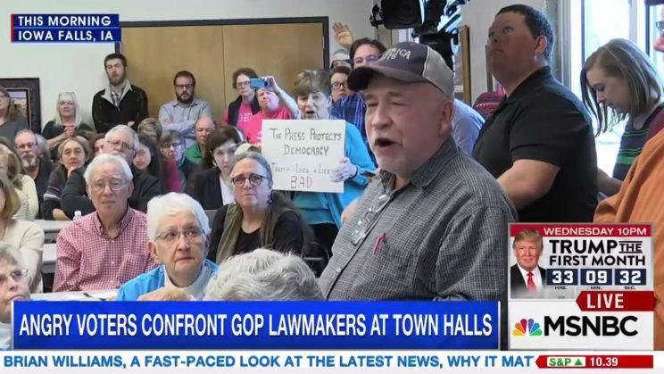 Farmer Chris Peterson pleads with Sen. Chuck Grassley in Iowa on Tuesday. (MSNBC)
