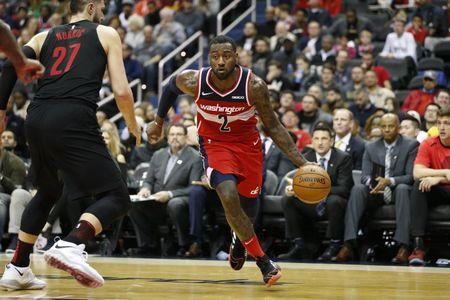 Nov 18, 2018; Washington, DC, USA; Washington Wizards guard John Wall (2) dribbles the ball around Portland Trail Blazers center Jusuf Nurkic (27) during the second quarter at Capital One Arena. Mandatory Credit: Amber Searls-USA TODAY Sports