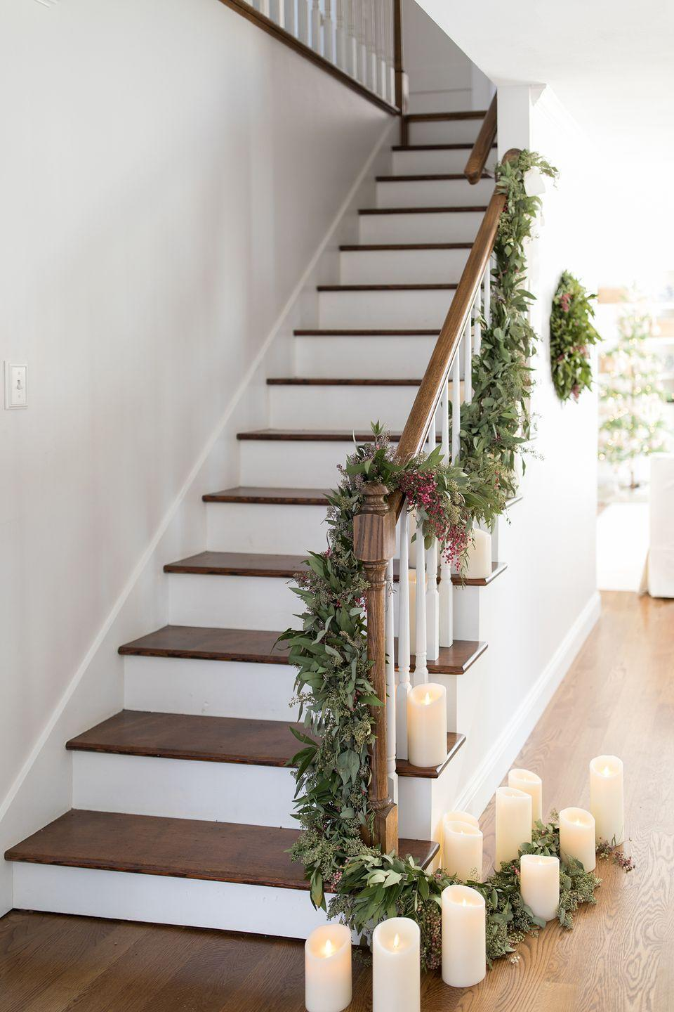 """<p>A warm, natural glow is impossible to resist with this relaxed holiday staircase look by <a href=""""https://julieblanner.com/"""" rel=""""nofollow noopener"""" target=""""_blank"""" data-ylk=""""slk:Julie Blanner"""" class=""""link rapid-noclick-resp"""">Julie Blanner</a>.</p>"""