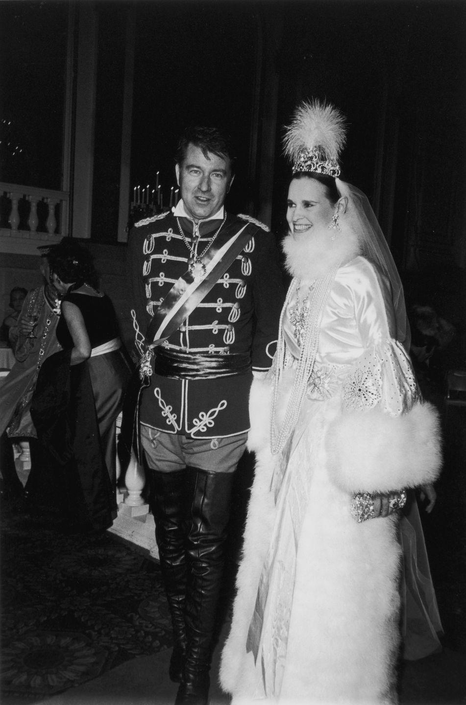 <p>Vanderbilt with her fourth husband, actor and editor Wyatt Cooper, at a ball in the Plaza Hotel. The theme: Winter Palace at St. Petersburg during the Romanov Dynasty.</p>
