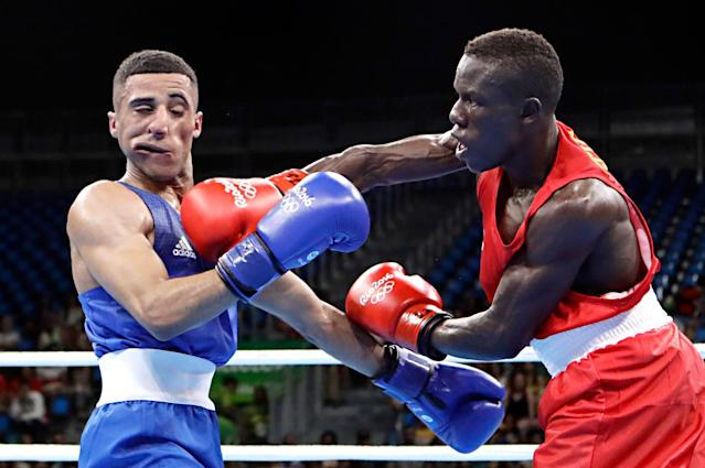 <p>Cameroon's Simplice Fotsala, right, fights Britain's Galal Yafai during a men's light flyweight 49-kg preliminary boxing match at the 2016 Summer Olympics in Rio de Janeiro, Brazil, Saturday, Aug. 6, 2016. (AP Photo/Frank Franklin II) </p>