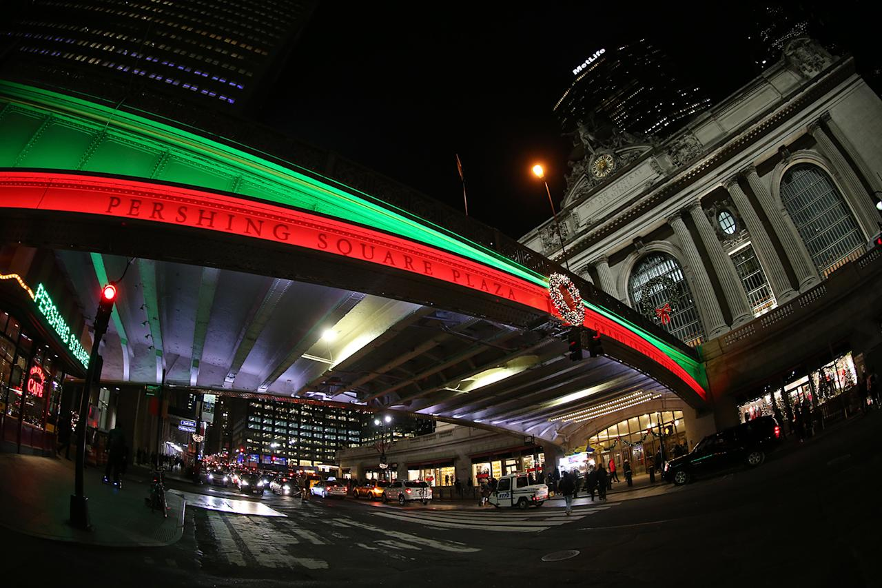 <p>Colored lights illuminate the bridge above E. 42nd St. at Pershing Square Plaza, across from Grand Central Terminal in New York City. (Gordon Donovan/Yahoo News) </p>