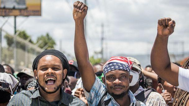 PHOTO: People gather in front of the US Embassy in Tabarre, Haiti on July 10, 2021, asking for asylum after the assassination of President Jovenel Moise amid fears of insecurity in the country. (Valerie Baeriswyl/AFP via Getty Images)