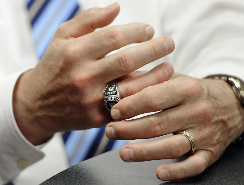 Penn State athletic director David Joyner touches his university wrestling championship ring as he interviewed by the Associated Press in Oxford, Conn., Wednesday, June 5, 2013. (AP Photo/Jessica Hill)