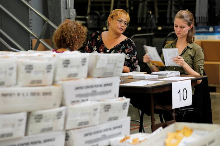 <p>Election workers deal with early mail-in ballots for the upcoming congressional elections in Orange County at the Registrar of Voters in Santa Ana, Calif., Oct. 30, 2018. (Photo: Mike Blake/Reuters) </p>