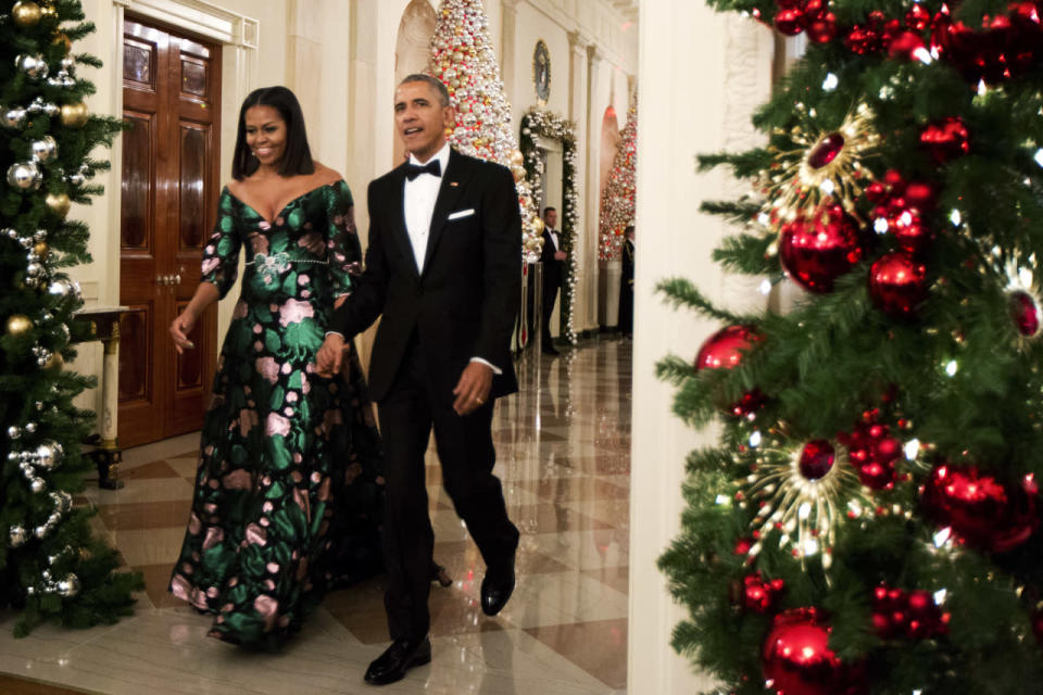 <p>If Michelle Obama was looking for a career in fashion after leaving the White House, she wouldn't be hard pressed to find one. The first lady, who's established herself as one of the most stylish women in the White House, stepped out in a gorgeous Gucci gown for the 2016 Kennedy Center Honors. The festive gown covered in pink flowers and greenery featured an off-the-shoulder silhouette and low-cut neckline. <i>(Photo: AP) </i></p>