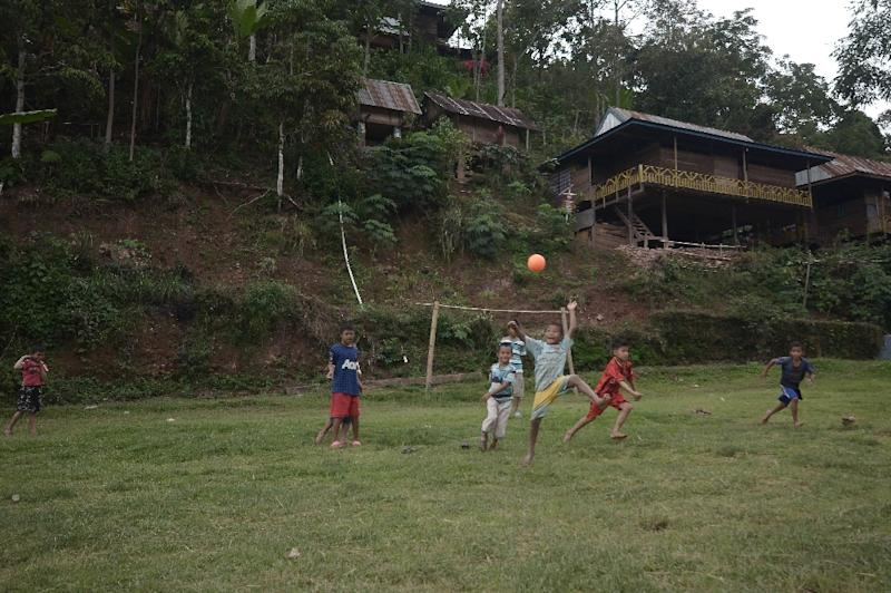 Children play football in Bone-Bone, the first village in Indonesia that has imposed a total ban on smoking (AFP Photo/Cening Unru)