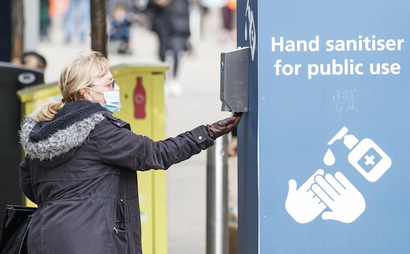 A woman uses a public hand sanitiser in Leeds city centre. (Photo: Danny Lawson - PA Images via Getty Images)